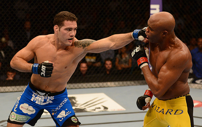 LAS VEGAS, NV - JULY 06:  (L-R) Chris Weidman punches Anderson Silva in their UFC middleweight championship fight during the UFC 162 event inside the MGM Grand Garden Arena on July 6, 2013 in Las Vegas, Nevada.  (Photo by Donald Miralle/Zuffa LLC/Zuffa LLC via Getty Images) *** Local Caption *** Anderson Silva; Chris Weidman