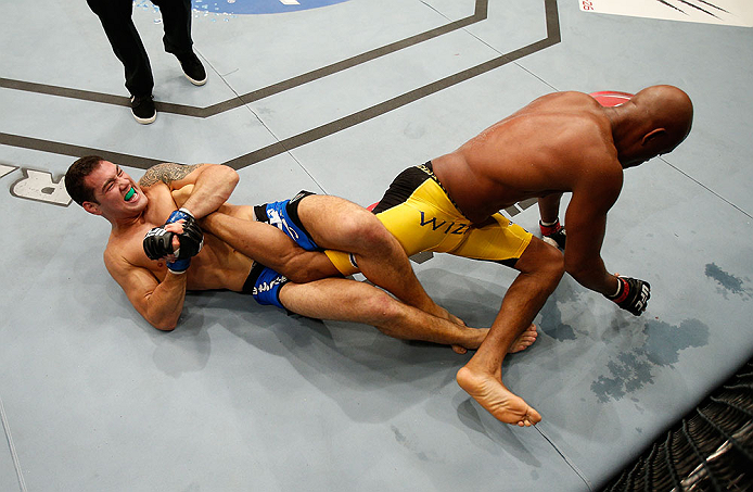 LAS VEGAS, NV - JULY 06:  Chris Weidman (left) attempts to submit Anderson Silva in their UFC middleweight championship fight during the UFC 162 event inside the MGM Grand Garden Arena on July 6, 2013 in Las Vegas, Nevada.  (Photo by Josh Hedges/Zuffa LLC/Zuffa LLC via Getty Images) *** Local Caption *** Anderson Silva; Chris Weidman