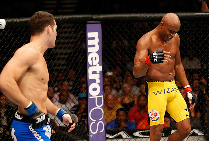 LAS VEGAS, NV - JULY 06:  Anderson Silva (right) taunts Chris Weidman in their UFC middleweight championship fight during the UFC 162 event inside the MGM Grand Garden Arena on July 6, 2013 in Las Vegas, Nevada.  (Photo by Josh Hedges/Zuffa LLC/Zuffa LLC via Getty Images) *** Local Caption *** Anderson Silva; Chris Weidman