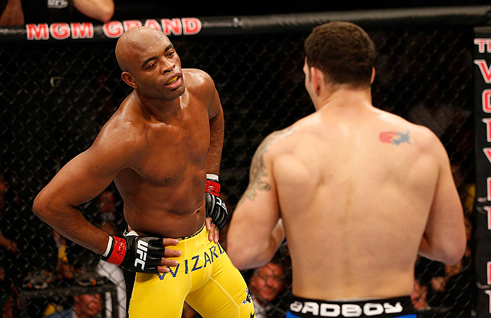 LAS VEGAS, NV - JULY 06:  Anderson Silva (left) taunts Chris Weidman in their UFC middleweight championship fight during the UFC 162 event inside the MGM Grand Garden Arena on July 6, 2013 in Las Vegas, Nevada.  (Photo by Josh Hedges/Zuffa LLC/Zuffa LLC via Getty Images) *** Local Caption *** Anderson Silva; Chris Weidman
