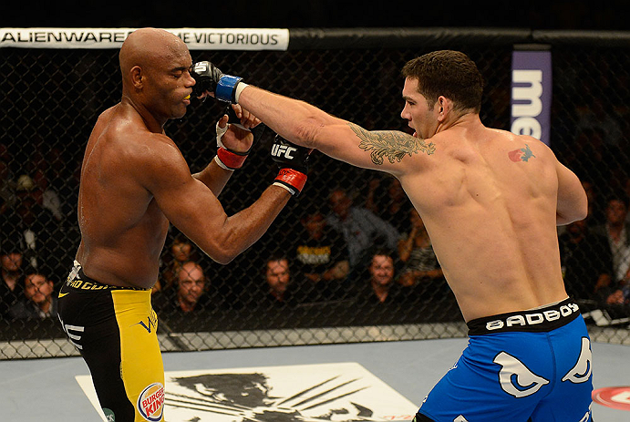 LAS VEGAS, NV - JULY 06:  (R-L) Chris Weidman punches Anderson Silva in their UFC middleweight championship fight during the UFC 162 event inside the MGM Grand Garden Arena on July 6, 2013 in Las Vegas, Nevada.  (Photo by Donald Miralle/Zuffa LLC/Zuffa LLC via Getty Images) *** Local Caption *** Anderson Silva; Chris Weidman