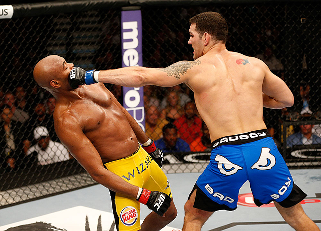 LAS VEGAS, NV - JULY 06:  (R-L) Chris Weidman punches Anderson Silva in their UFC middleweight championship fight during the UFC 162 event inside the MGM Grand Garden Arena on July 6, 2013 in Las Vegas, Nevada.  (Photo by Josh Hedges/Zuffa LLC/Zuffa LLC via Getty Images) *** Local Caption *** Anderson Silva; Chris Weidman
