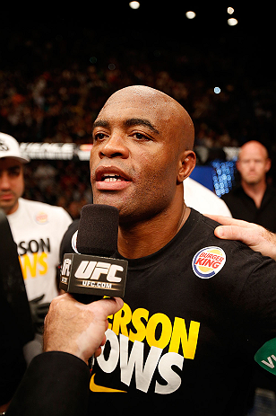 LAS VEGAS, NV - JULY 06:  Anderson Silva is interviewed after his loss to Chris Weidman in their UFC middleweight championship fight during the UFC 162 event inside the MGM Grand Garden Arena on July 6, 2013 in Las Vegas, Nevada.  (Photo by Josh Hedges/Zuffa LLC/Zuffa LLC via Getty Images) *** Local Caption *** Anderson Silva; Chris Weidman