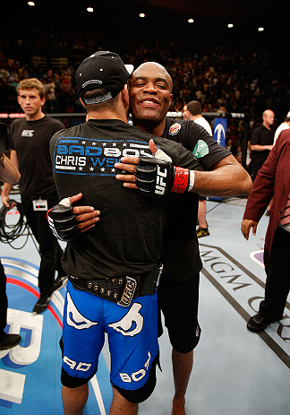 LAS VEGAS, NV - JULY 06:  (L-R) Chris Weidman and Anderson Silva embrace after their UFC middleweight championship fight during the UFC 162 event inside the MGM Grand Garden Arena on July 6, 2013 in Las Vegas, Nevada.  (Photo by Josh Hedges/Zuffa LLC/Zuffa LLC via Getty Images) *** Local Caption *** Anderson Silva; Chris Weidman