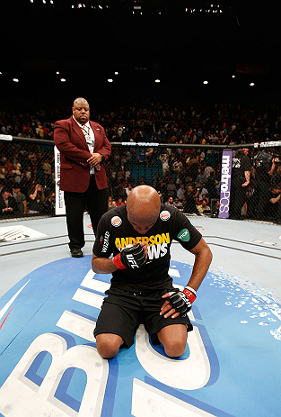 LAS VEGAS, NV - JULY 06:  A dejected Anderson Silva kneels in the Octagon after his loss to Chris Weidman in their UFC middleweight championship fight during the UFC 162 event inside the MGM Grand Garden Arena on July 6, 2013 in Las Vegas, Nevada.  (Photo by Josh Hedges/Zuffa LLC/Zuffa LLC via Getty Images) *** Local Caption *** Anderson Silva; Chris Weidman
