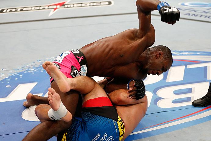 RIO DE JANEIRO, BRAZIL - AUGUST 03:  (L-R) Phil Davis punches Lyoto Machida in their light heavyweight bout during UFC 163 at HSBC Arena on August 3, 2013 in Rio de Janeiro, Brazil. (Photo by Josh Hedges/Zuffa LLC/Zuffa LLC via Getty Images)