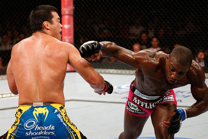 RIO DE JANEIRO, BRAZIL - AUGUST 03:  (R-L) Phil Davis punches Lyoto Machida in their light heavyweight bout during UFC 163 at HSBC Arena on August 3, 2013 in Rio de Janeiro, Brazil. (Photo by Josh Hedges/Zuffa LLC/Zuffa LLC via Getty Images)