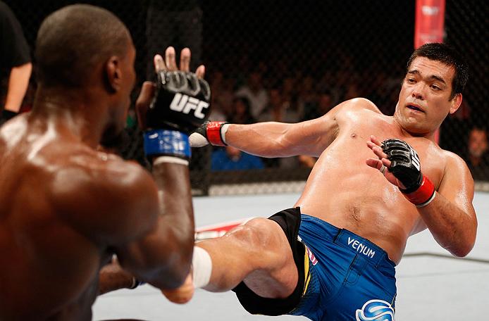 RIO DE JANEIRO, BRAZIL - AUGUST 03:  (R-L) Lyoto Machida kicks Phil Davis in their light heavyweight bout during UFC 163 at HSBC Arena on August 3, 2013 in Rio de Janeiro, Brazil. (Photo by Josh Hedges/Zuffa LLC/Zuffa LLC via Getty Images)