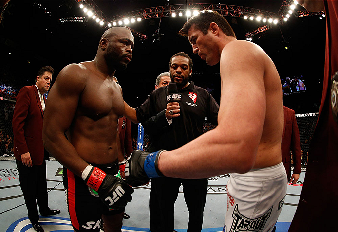 LAS VEGAS, NV - NOVEMBER 16:  Rashad Evans (left) and Chael Sonnen (right) touch gloves in their light heavyweight bout during the UFC 167 event inside the MGM Grand Garden Arena on November 16, 2013 in Las Vegas, Nevada. (Photo by Josh Hedges/Zuffa LLC/Zuffa LLC via Getty Images) *** Local Caption *** Rashad Evans; Chael Sonnen
