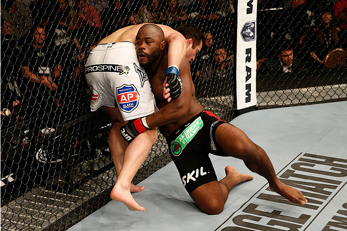 LAS VEGAS, NV - NOVEMBER 16:  Rashad Evans (pictured) takes down Chael Sonnen in their light heavyweight bout during the UFC 167 event inside the MGM Grand Garden Arena on November 16, 2013 in Las Vegas, Nevada. (Photo by Josh Hedges/Zuffa LLC/Zuffa LLC via Getty Images) *** Local Caption *** Rashad Evans; Chael Sonnen