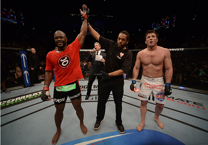 LAS VEGAS, NV - NOVEMBER 16:  Rashad Evans (left) is declared the winner over Chael Sonnen in their light heavyweight bout during the UFC 167 event inside the MGM Grand Garden Arena on November 16, 2013 in Las Vegas, Nevada. (Photo by Donald Miralle/Zuffa LLC/Zuffa LLC via Getty Images) *** Local Caption *** Rashad Evans; Chael Sonnen