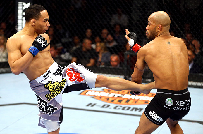 CHICAGO, IL - JANUARY 26:  John Dodson (L) kicks Demetrious Johnson (R) during thier Flyweight Championship Bout part of UFC on FOX at United Center on January 26, 2013 in Chicago, Illinois.  (Photo by Al Bello/Zuffa LLC/Zuffa LLC Via Getty Images)