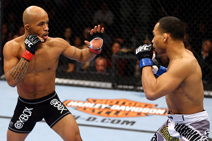John Dodson (R) fights Demetrious Johnson (L) during thier Flyweight Championship Bout part of UFC on FOX at United Center on January 26, 2013 in Chicago, IL. (Photo by Al Bello/Zuffa LLC)