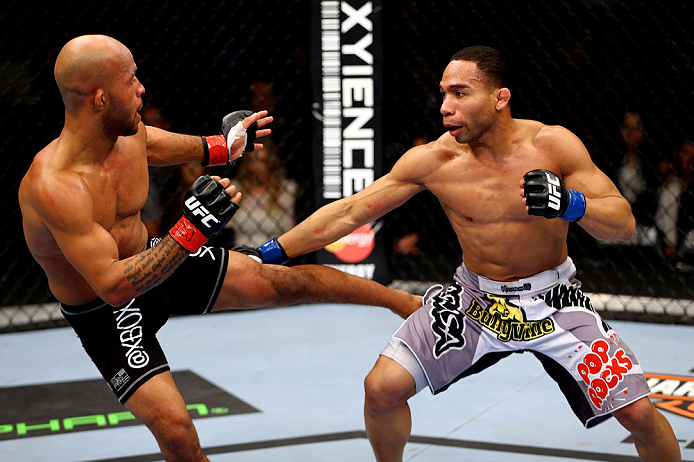 CHICAGO, IL - JANUARY 26:  Demetrious Johnson (L) kicks John Dodson (R) during thier Flyweight Championship Bout part of UFC on FOX at United Center on January 26, 2013 in Chicago, Illinois.  (Photo by Al Bello/Zuffa LLC/Zuffa LLC Via Getty Images)