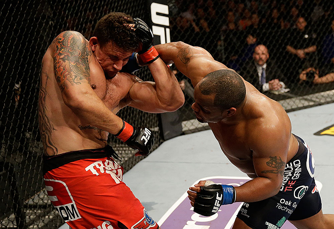 SAN JOSE, CA - APRIL 20:   (R-L) Daniel Cormier punches Frank Mir in their heavyweight bout during the UFC on FOX event at the HP Pavilion on April 20, 2013 in San Jose, California.  (Photo by Ezra Shaw/Zuffa LLC/Zuffa LLC via Getty Images)  *** Local Caption *** Frank Mir; Daniel Cormier