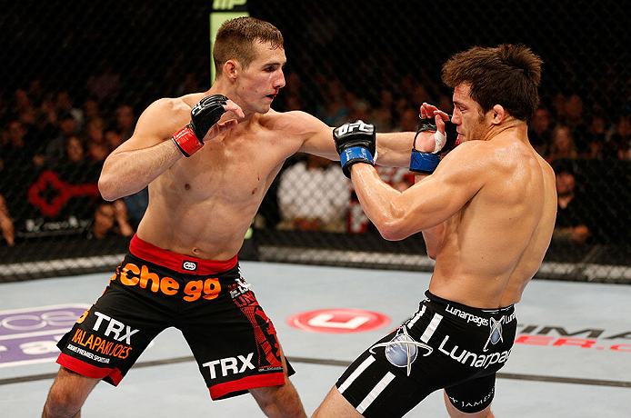 SEATTLE, WA - JULY 27: (L-R) Rory MacDonald punches Jake Ellenberger in their welterweight bout during the UFC on FOX event at Key Arena on July 27, 2013 in Seattle, Washington. (Photo by Josh Hedges/Zuffa LLC/Zuffa LLC via Getty Images) *** Local Caption *** Rory MacDonald; Jake Ellenberger