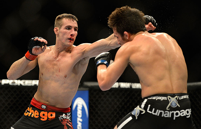 SEATTLE, WA - JULY 27: (L-R) Rory MacDonald punches Jake Ellenberger in their welterweight bout during the UFC on FOX event at Key Arena on July 27, 2013 in Seattle, Washington. (Photo by Jeff Bottari/Zuffa LLC/Zuffa LLC via Getty Images) *** Local Caption *** Rory MacDonald; Jake Ellenberger