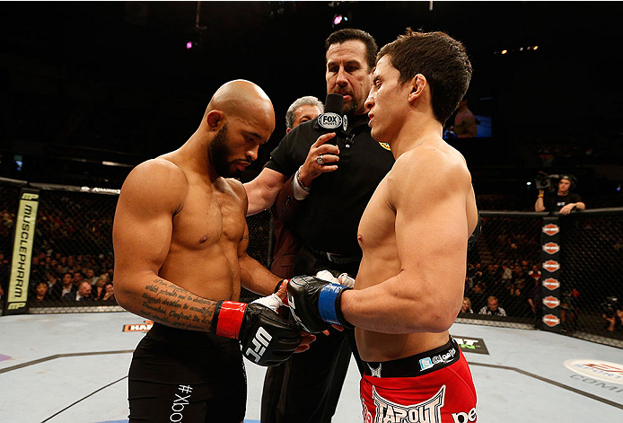SACRAMENTO, CA - DECEMBER 14:  (L-R) Demetrious Johnson and Joseph Benavidez touch gloves before their flyweight championship bout during the UFC on FOX event at Sleep Train Arena on December 14, 2013 in Sacramento, California. (Photo by Josh Hedges/Zuffa LLC/Zuffa LLC via Getty Images) *** Local Caption *** Demetrious Johnson; Joseph Benavidez