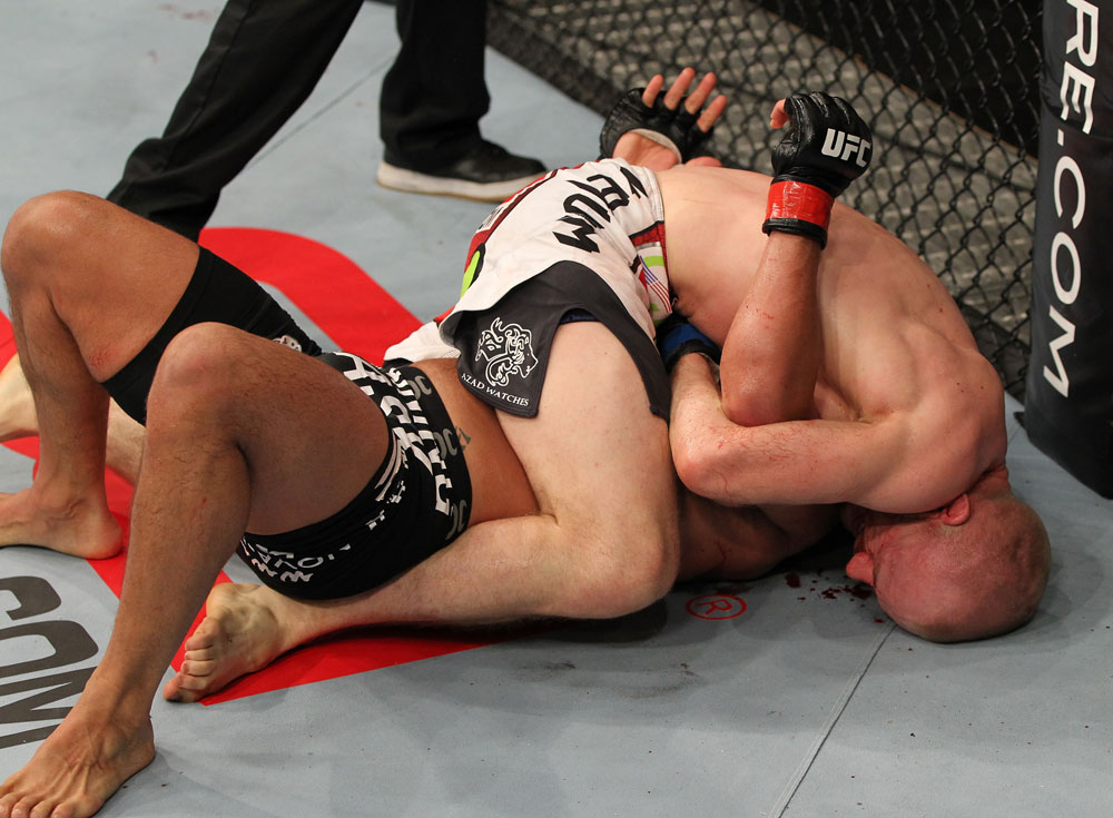 SYDNEY, AUSTRALIA - MARCH 03:  (R-L) Martin Kampmann secures a guillotine choke submission to defeat Thiago Alves in a welterweight bout during the UFC on FX event at Allphones Arena on March 3, 2012 in Sydney, Australia.  (Photo by Josh Hedges/Zuffa LLC/Zuffa LLC via Getty Images) *** Local Caption *** Thiago Alves; Martin Kampmann