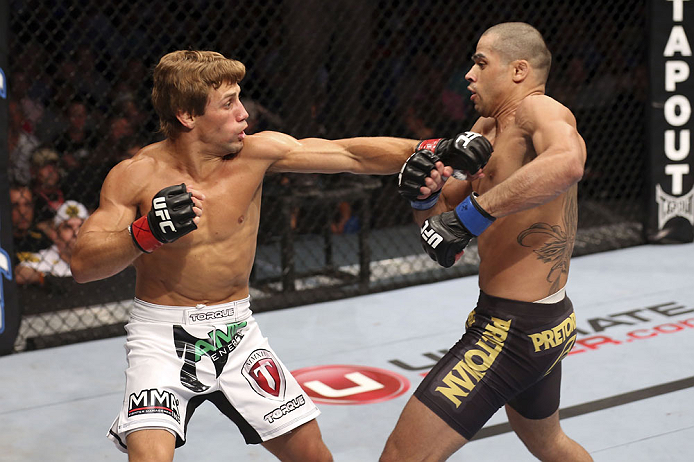 CALGARY, CANADA - JULY 21: (L-R) Urijah Faber throws a punch at Renan Barao during their UFC interim bantamweight championship bout at UFC 149 inside the Scotiabank Saddledome on July 21, 2012 in Calgary, Alberta, Canada.  (Photo by Nick Laham/Zuffa LLC/Zuffa LLC via Getty Images)