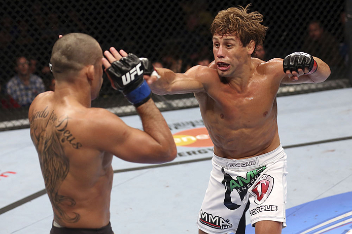 CALGARY, CANADA - JULY 21: (R-L) Urijah Faber throws a punch at Renan Barao during their UFC interim bantamweight championship bout at UFC 149 inside the Scotiabank Saddledome on July 21, 2012 in Calgary, Alberta, Canada.  (Photo by Nick Laham/Zuffa LLC/Zuffa LLC via Getty Images)