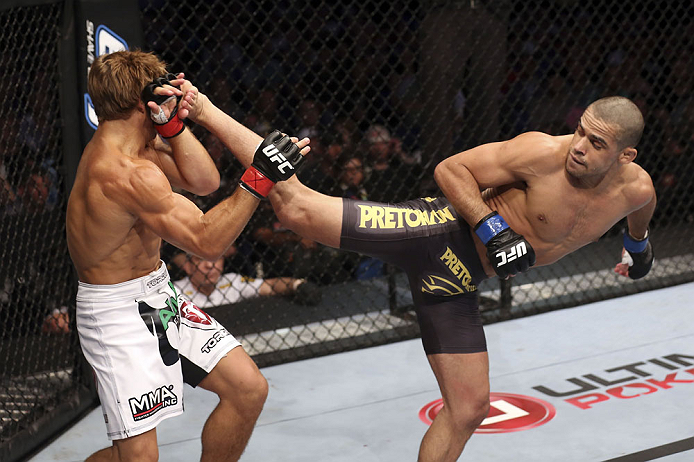 CALGARY, CANADA - JULY 21: (L-R) Urijah Faber blocks a kick from Renan Barao during their UFC interim bantamweight championship bout at UFC 149 inside the Scotiabank Saddledome on July 21, 2012 in Calgary, Alberta, Canada.  (Photo by Nick Laham/Zuffa LLC/Zuffa LLC via Getty Images)