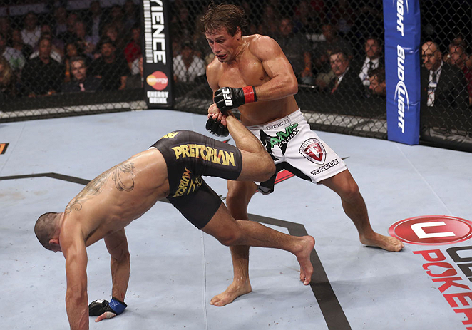 CALGARY, CANADA - JULY 21: (R-L) Urijah Faber counters a kick from Renan Barao during their UFC interim bantamweight championship bout at UFC 149 inside the Scotiabank Saddledome on July 21, 2012 in Calgary, Alberta, Canada.  (Photo by Nick Laham/Zuffa LLC/Zuffa LLC via Getty Images)