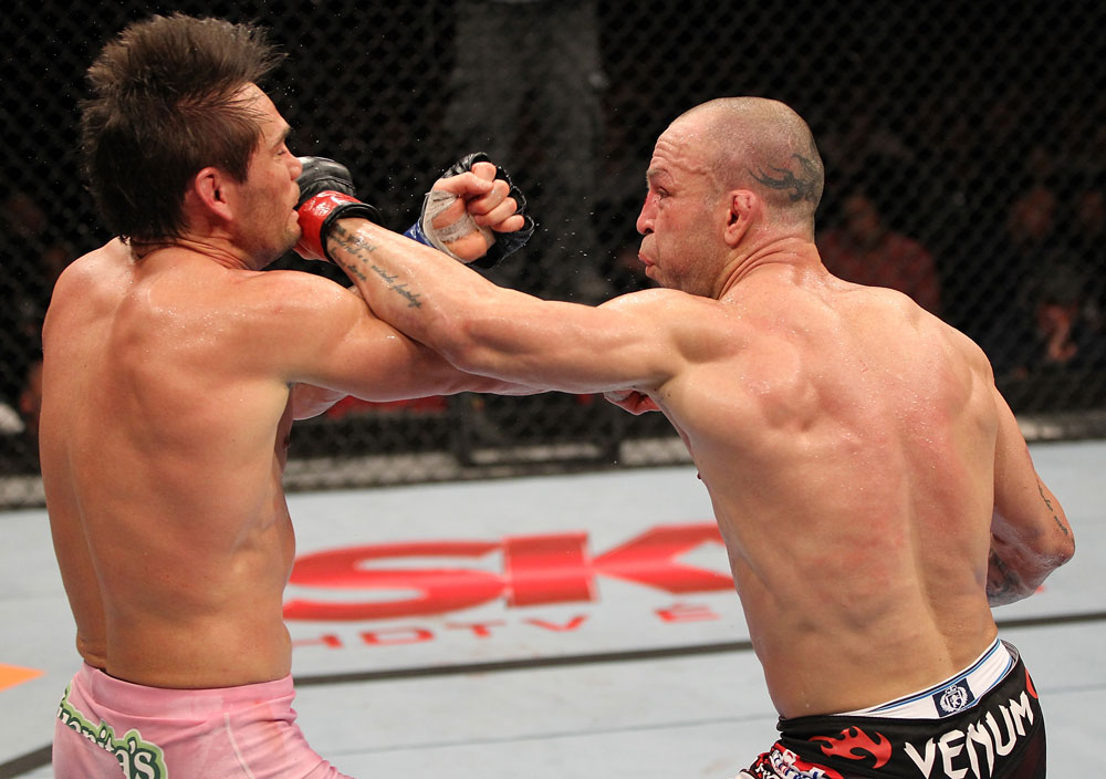 BELO HORIZONTE, BRAZIL - JUNE 23:   (R-L) Wanderlei Silva punches Rich Franklin during their UFC 147 catchweight bout at Estadio Jornalista Felipe Drummond on June 23, 2012 in Belo Horizonte, Brazil.  (Photo by Josh Hedges/Zuffa LLC/Zuffa LLC via Getty Images)