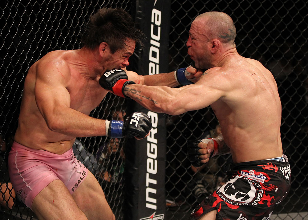 BELO HORIZONTE, BRAZIL - JUNE 23:  (R-L) Wanderlei Silva and Rich Franklin trade punches during their UFC 147 catchweight bout at Estadio Jornalista Felipe Drummond on June 23, 2012 in Belo Horizonte, Brazil.  (Photo by Josh Hedges/Zuffa LLC/Zuffa LLC via Getty Images)