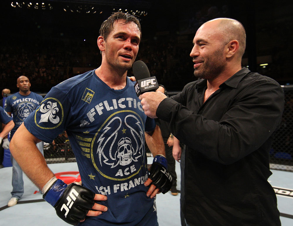 BELO HORIZONTE, BRAZIL - JUNE 23:   Rich Franklin (L) is interviewed by Joe Rogan after defeating Wanderlei Silva at Estadio Jornalista Felipe Drummond on June 23, 2012 in Belo Horizonte, Brazil.  (Photo by Josh Hedges/Zuffa LLC/Zuffa LLC via Getty Images)