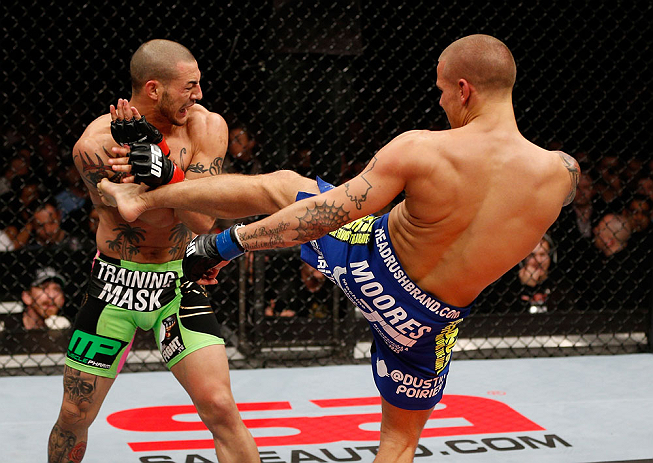 LONDON, ENGLAND - FEBRUARY 16:  (R-L) Dustin Poirier kicks Cub Swanson in their featherweight fight during the UFC on Fuel TV event on February 16, 2013 at Wembley Arena in London, England.  (Photo by Josh Hedges/Zuffa LLC/Zuffa LLC via Getty Images)