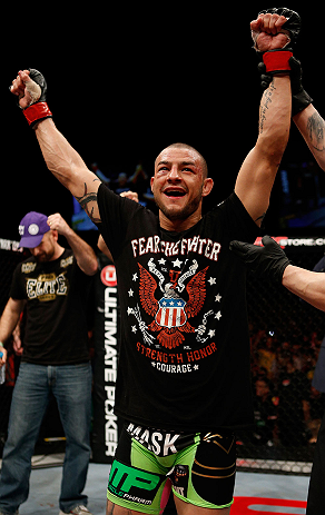 LONDON, ENGLAND - FEBRUARY 16:  Cub Swanson reacts after defeating Dustin Poirier in their featherweight fight during the UFC on Fuel TV event on February 16, 2013 at Wembley Arena in London, England.  (Photo by Josh Hedges/Zuffa LLC/Zuffa LLC via Getty Images)