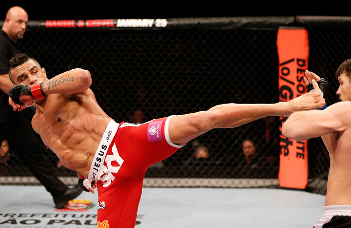 SAO PAULO, BRAZIL - JANUARY 19:  (L-R) Vitor Belfort kicks Michael Bisping in their middleweight fight at the UFC on FX event on January 19, 2013 at Ibirapuera Gymnasium in Sao Paulo, Brazil. (Photo by Josh Hedges/Zuffa LLC/Zuffa LLC via Getty Images)