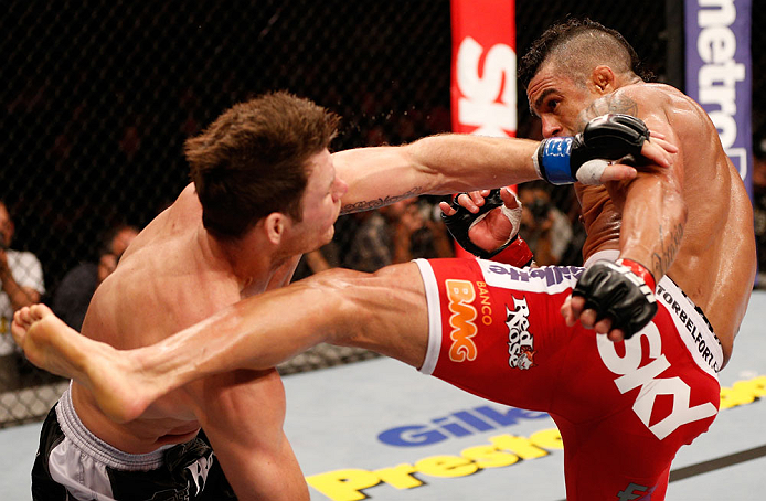 SAO PAULO, BRAZIL - JANUARY 19:  (R-L) Vitor Belfort kicks Michael Bisping in their middleweight fight at the UFC on FX event on January 19, 2013 at Ibirapuera Gymnasium in Sao Paulo, Brazil. (Photo by Josh Hedges/Zuffa LLC/Zuffa LLC via Getty Images)