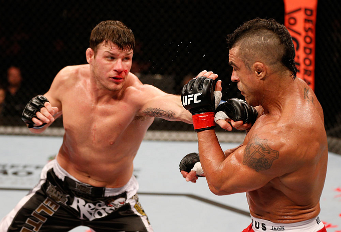 SAO PAULO, BRAZIL - JANUARY 19:  (L-R) Michael Bisping punches Vitor Belfort in their middleweight fight at the UFC on FX event on January 19, 2013 at Ibirapuera Gymnasium in Sao Paulo, Brazil. (Photo by Josh Hedges/Zuffa LLC/Zuffa LLC via Getty Images)