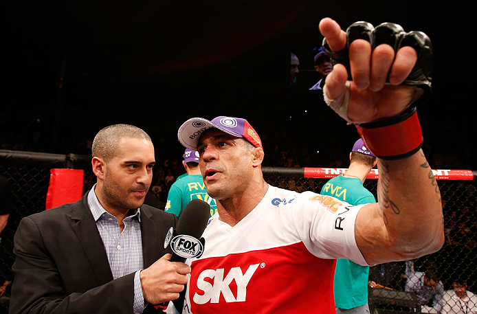 SAO PAULO, BRAZIL - JANUARY 19:  (R-L) Vitor Belfort is interviewed by Jon Anik after knocking out Michael Bisping in their middleweight fight at the UFC on FX event on January 19, 2013 at Ibirapuera Gymnasium in Sao Paulo, Brazil. (Photo by Josh Hedges/Zuffa LLC/Zuffa LLC via Getty Images)