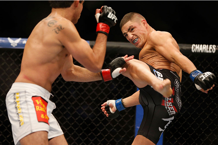 HOUSTON, TEXAS - OCTOBER 19:  (R-L) Diego Sanchez kicks Gilbert Melendez in their UFC lightweight bout at the Toyota Center on October 19, 2013 in Houston, Texas. (Photo by Josh Hedges/Zuffa LLC/Zuffa LLC via Getty Images)