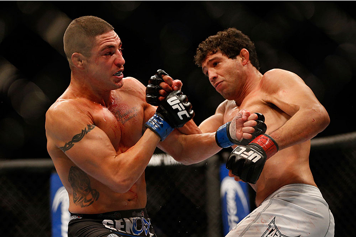 HOUSTON, TEXAS - OCTOBER 19:  (R-L) Gilbert Melendez punches Diego Sanchez in their UFC lightweight bout at the Toyota Center on October 19, 2013 in Houston, Texas. (Photo by Josh Hedges/Zuffa LLC/Zuffa LLC via Getty Images)