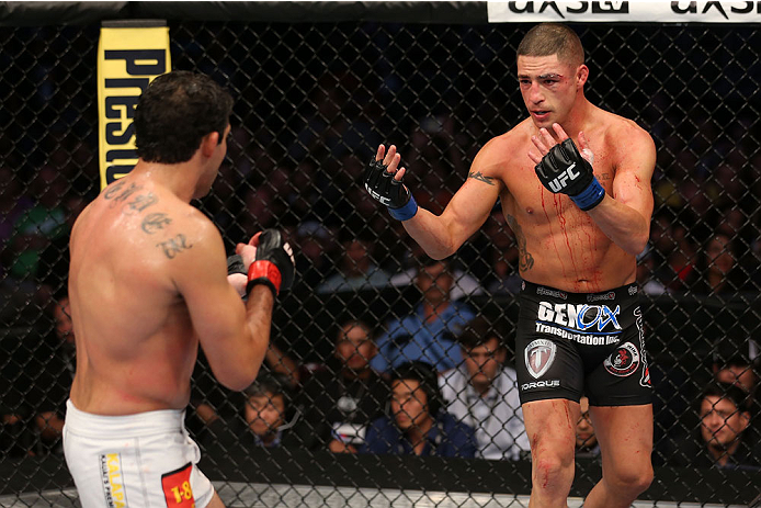 HOUSTON, TEXAS - OCTOBER 19:  (R-L) Diego Sanchez taunts Gilbert Melendez in their UFC lightweight bout at the Toyota Center on October 19, 2013 in Houston, Texas. (Photo by Nick Laham/Zuffa LLC/Zuffa LLC via Getty Images)