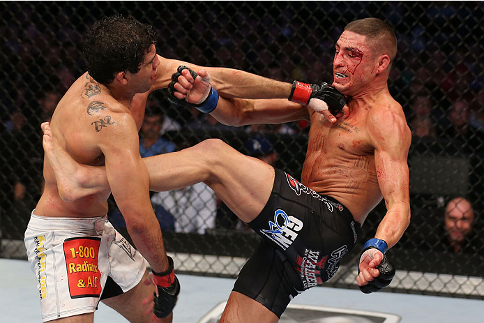 HOUSTON, TEXAS - OCTOBER 19:  (R-L) Diego Sanchez kicks Gilbert Melendez in their UFC lightweight bout at the Toyota Center on October 19, 2013 in Houston, Texas. (Photo by Nick Laham/Zuffa LLC/Zuffa LLC via Getty Images)