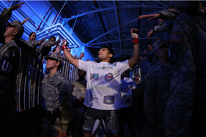 FORT CAMPBELL, KENTUCKY - NOVEMBER 6:  Ronny Markes walks to the Octagon to face Yoel Romero in their UFC middleweight bout on November 6, 2013 in Fort Campbell, Kentucky. (Photo by Ed Mulholland/Zuffa LLC/Zuffa LLC via Getty Images) *** Local Caption ***Ronny Markes