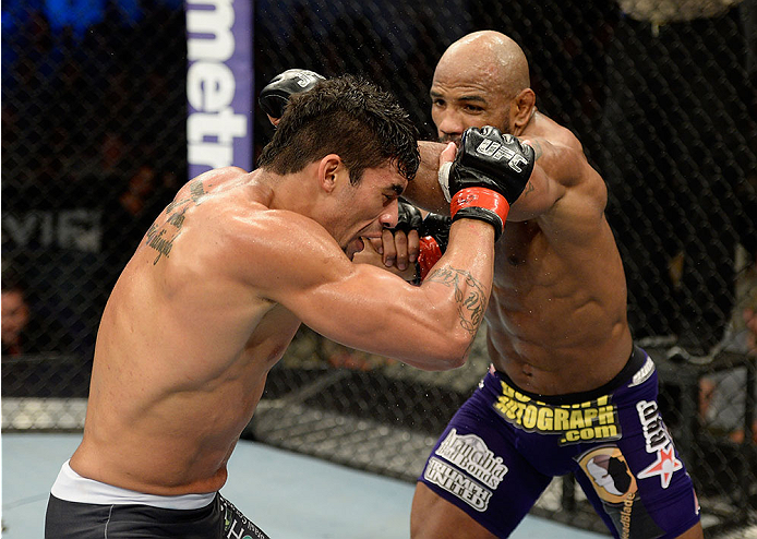 FORT CAMPBELL, KENTUCKY - NOVEMBER 6:  (R-L) Yoel Romero punches Ronny Markes in their UFC middleweight bout on November 6, 2013 in Fort Campbell, Kentucky. (Photo by Jeff Bottari/Zuffa LLC/Zuffa LLC via Getty Images) *** Local Caption ***Ronny Markes; Yoel Romero