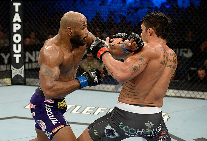 FORT CAMPBELL, KENTUCKY - NOVEMBER 6:  (L-R) Yoel Romero punches Ronny Markes in their UFC middleweight bout on November 6, 2013 in Fort Campbell, Kentucky. (Photo by Jeff Bottari/Zuffa LLC/Zuffa LLC via Getty Images) *** Local Caption ***Ronny Markes; Yoel Romero