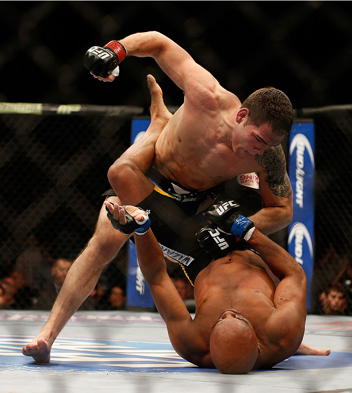 LAS VEGAS, NV - DECEMBER 28:  Chris Weidman (top) punches Anderson Silva in their UFC middleweight championship bout during the UFC 168 event at the MGM Grand Garden Arena on December 28, 2013 in Las Vegas, Nevada. (Photo by Josh Hedges/Zuffa LLC/Zuffa LLC via Getty Images) *** Local Caption *** Chris Weidman; Anderson Silva