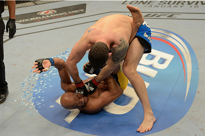 LAS VEGAS, NV - DECEMBER 28:  Chris Weidman (top) punches Anderson Silva in their UFC middleweight championship bout during the UFC 168 event at the MGM Grand Garden Arena on December 28, 2013 in Las Vegas, Nevada. (Photo by Donald Miralle/Zuffa LLC/Zuffa LLC via Getty Images) *** Local Caption *** Chris Weidman; Anderson Silva