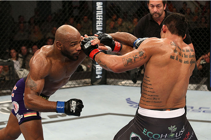 FORT CAMPBELL, KENTUCKY - NOVEMBER 6:  (L-R) Yoel Romero punches Ronny Markes in their UFC middleweight bout on November 6, 2013 in Fort Campbell, Kentucky. (Photo by Ed Mulholland/Zuffa LLC/Zuffa LLC via Getty Images) *** Local Caption ***Ronny Markes; Yoel Romero