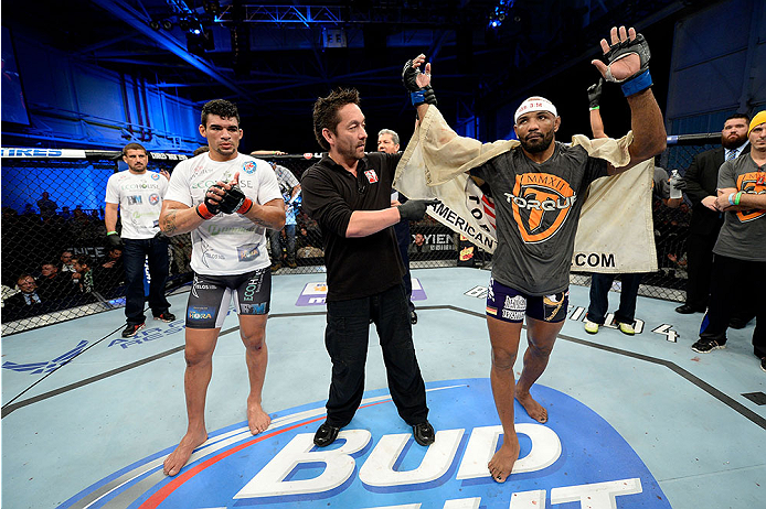 FORT CAMPBELL, KENTUCKY - NOVEMBER 6:  Yoel Romero (right) is declared the winner over Ronny Markes (left) in their UFC middleweight bout on November 6, 2013 in Fort Campbell, Kentucky. (Photo by Jeff Bottari/Zuffa LLC/Zuffa LLC via Getty Images) *** Local Caption ***Ronny Markes; Yoel Romero