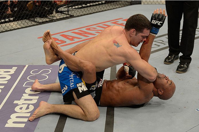 LAS VEGAS, NV - DECEMBER 28:  Chris Weidman (top) elbows Anderson Silva in their UFC middleweight championship bout during the UFC 168 event at the MGM Grand Garden Arena on December 28, 2013 in Las Vegas, Nevada. (Photo by Donald Miralle/Zuffa LLC/Zuffa LLC via Getty Images) *** Local Caption *** Chris Weidman; Anderson Silva