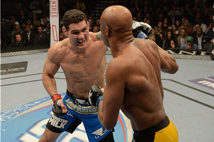 LAS VEGAS, NV - DECEMBER 28:  (L-R) Chris Weidman punches Anderson Silva in their UFC middleweight championship bout during the UFC 168 event at the MGM Grand Garden Arena on December 28, 2013 in Las Vegas, Nevada. (Photo by Donald Miralle/Zuffa LLC/Zuffa LLC via Getty Images) *** Local Caption *** Chris Weidman; Anderson Silva