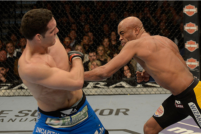 LAS VEGAS, NV - DECEMBER 28:  (R-L) Anderson Silva punches Chris Weidman in their UFC middleweight championship bout during the UFC 168 event at the MGM Grand Garden Arena on December 28, 2013 in Las Vegas, Nevada. (Photo by Donald Miralle/Zuffa LLC/Zuffa LLC via Getty Images) *** Local Caption *** Chris Weidman; Anderson Silva